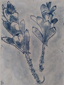 Two blue pine cones on Asian paper
